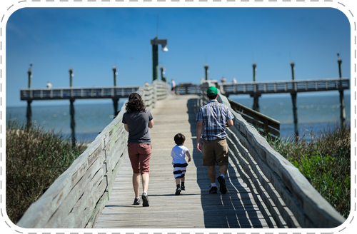 family walking on pier